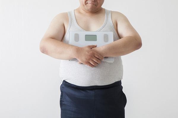 体重計を持つデブ